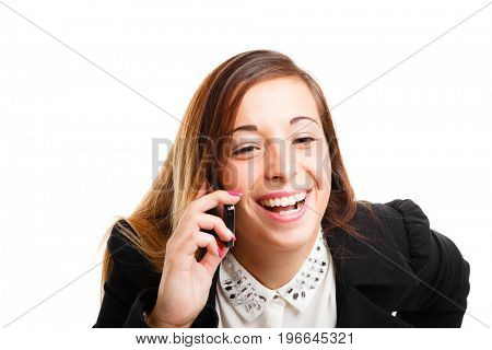 Portrait of a cheerful woman talking on the phone. Isolated on white