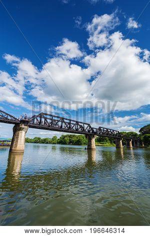 Tourists On The Bridge River Kwai In Kanchanaburi, Thailand