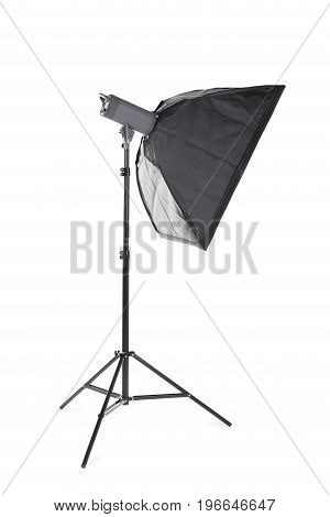 A professional studio softbox isolated over the white background. A dark saturated black softbox on a long metal tripod. Photographic equipment for photographers. Photo business.