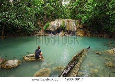 People Traveling And Bath In Erawan Waterfall, Thailand