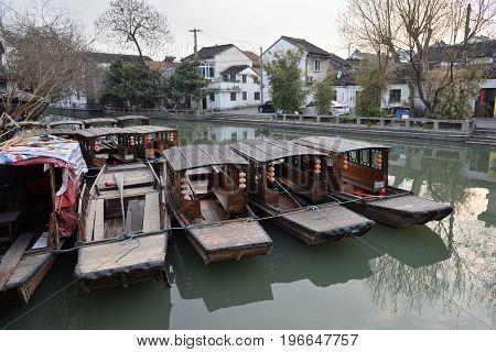 SUZHOU CHINA - MARCH 21: Traditional chinese boats on March 21 2016 in Suzhou China. Suzhou is a major city located in southeastern Jiangsu Province of East China.