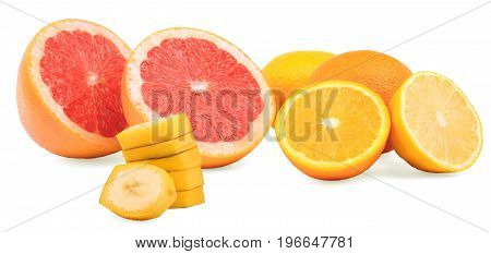 Healthful and juicy citruses isolated on a white background. Sliced nutritious banana and cut oranges, bitter lemons and tropical grapefruits. Freshness, nature and vitamin concept.