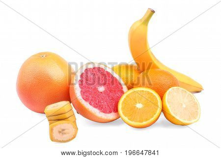 Various tasteful citruses isolated over the white background. Raw sliced grapefruits, ripe oranges, cut banana and yellow lemons. Fresh and organic citruses for sweet fruit salads.