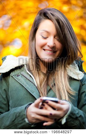 Young woman sending a sms