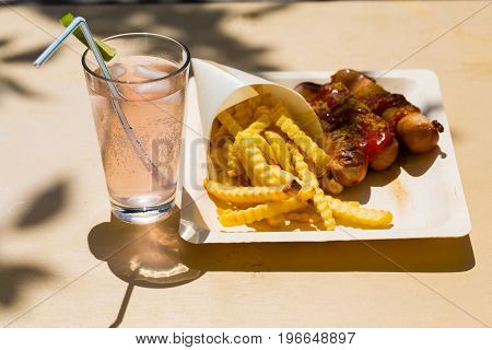 Currywurst and pommes and limonade, german food