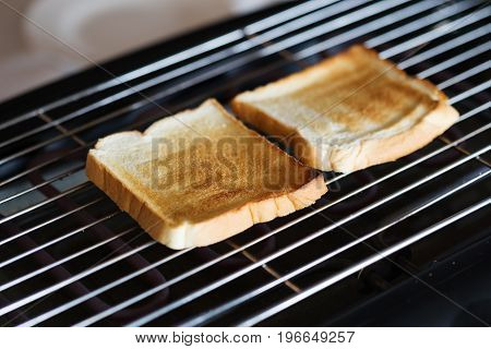 Toast bread on the toaster in hotel