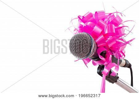 Chrome microphone and stand with pink bow isolated on white background, clipping path.