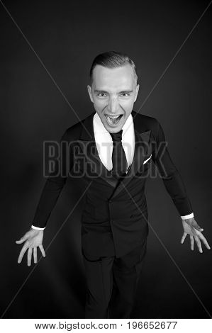 screaming young business man. crisis concept. angry businessman in tuxedo