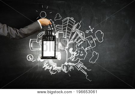 Hand holding lantern