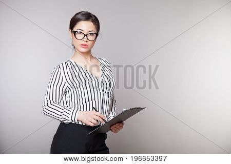 business girl in glasses sits in the Office 1