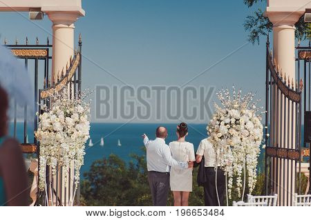 Wedding. Happy Couple Day After Wedding. Beautiful Couple Embrace With Open Arms Looking At The Sea