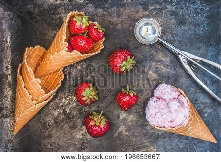 Waffle Cone With Strawberry Ice Cream, Spoon For Ice Cream And Fresh Berries On A Dark Background, T