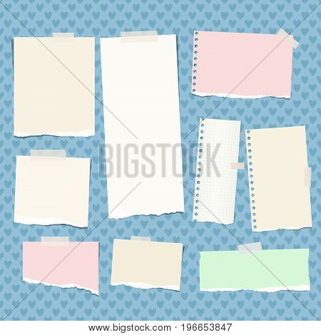 Ripped colorful, pastel note, notebook, copybook strips stuck with sticky tape on blue background created from heart shapes
