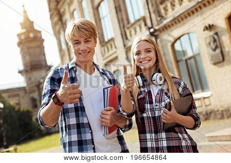 Academic temple. Two capable energetic outgoing people looking excited while attending classes and learning new helpful things