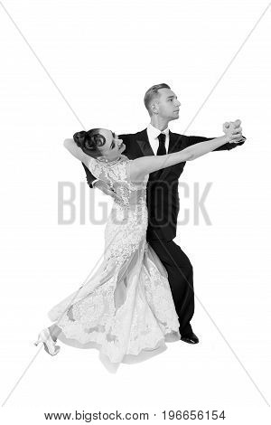 dance ballroom couple in a dance pose isolated on white background. sensual professional dancers dancing tango black and white