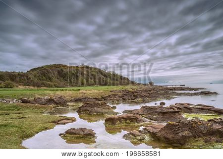 Rock Pool at Portencross bay Seamill with Castle and Jetty in the distance and also Ailsa Craig in the far distance.