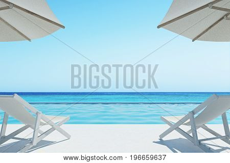 Two deck chairs are standing under beach umbrellas on an ocean shore. Concept of rest. 3d rendering mock up