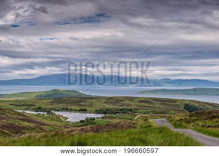 Hazy Arran under clouds in Summer with good detail on Arran taken from Fairlie Moor near Largs Ayrshire Scotland.