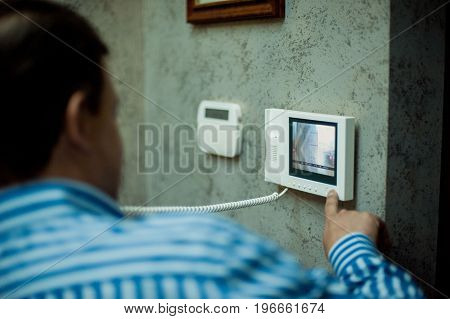 The Man Presses The Button Of The Intercom Panel