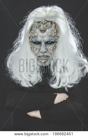 Man With Reptilian Skin And Long Grey Hair