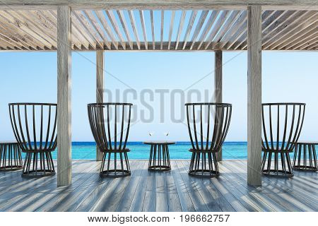 Dark wooden chairs and small round tables with cocktails in an outdoors cafe with a wooden ceiling and floor. Seaside with a cloudless sky. 3d rendering mock up