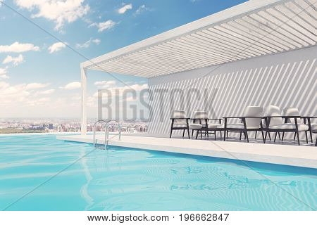 Row of white armchairs is standing along a swimming pool. A blue sky with clouds is above them. 3d rendering mock up