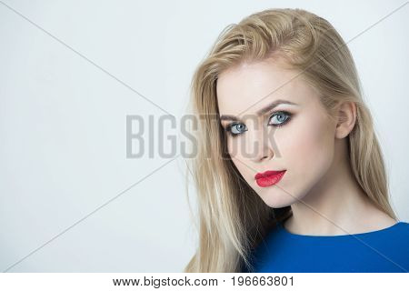 Lady with red lips on pretty face. Adorable girl or young woman with blue eyes bright makeup and long blond hair posing isolated on white. Fashion make up and visage. Beauty salon copy space