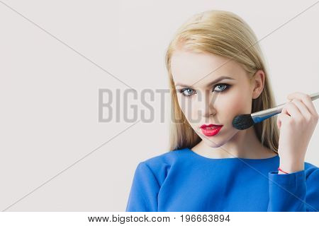 Girl Applying Powder On Face Skin With Makeup Brush