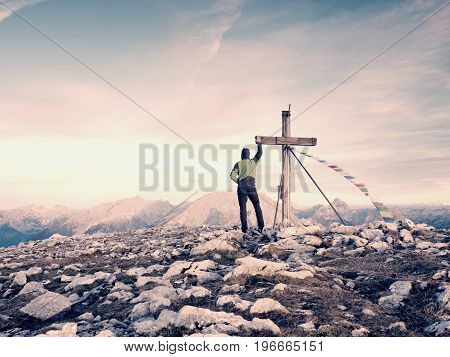 Man Tourist Walk To Cross On The Mountain Peak. Evening Dark,colorful  Sky During Sunset