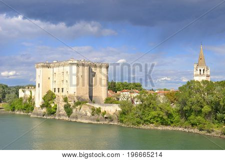 View to King Rene's castle and St Martha's Church from Rhone river in Tarascon France