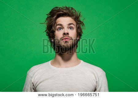 hair and beard of surprised man in white underwear on green background morning and fashion barbershop