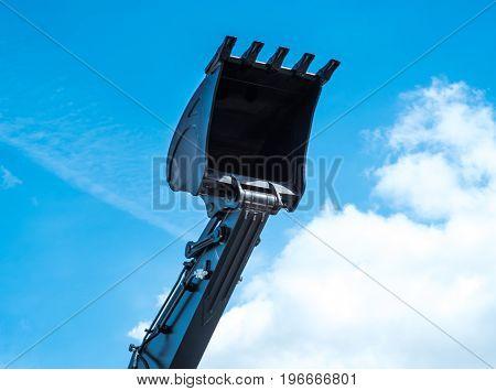 single digger shovel isolated on blue sky