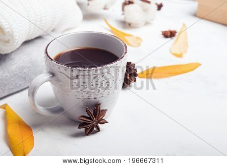 Coffee, sweaters and yellow leaves. Autumn morning concept