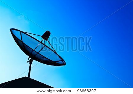 Black Satellite dish in blue sky background