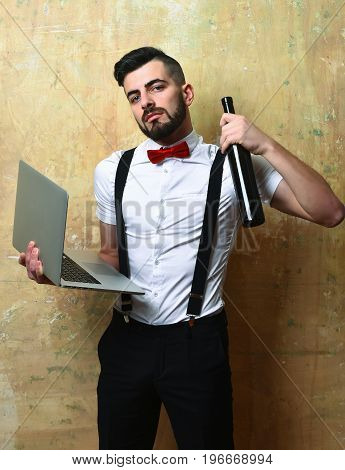 Guy With Serious Face With Grey Computer And Alcohol
