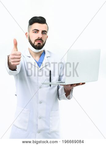 Doctor With Beard Holds White Laptop And Shows Thumbs Up