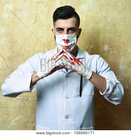 Surgeon With Hands In Blood And Confident Sight