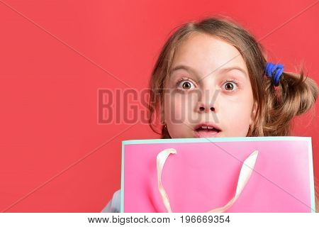 Kid With Surprised Face Expression And Stylish Hairdo