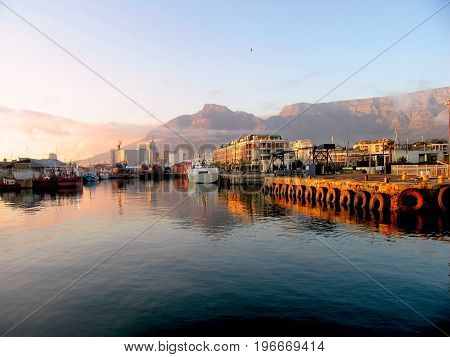 SUN SETTING OVER THE VICTORIA AND ALFRED WATERFRONT, CAPE TOWN, SOUTH AFRICA 22xx