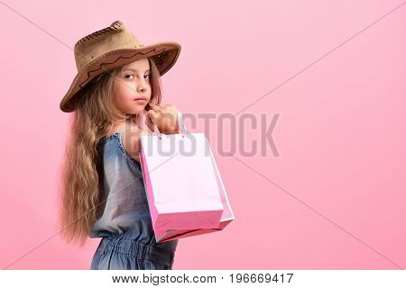 Kid With Serious Face Expression And Stylish Cowboy Hat