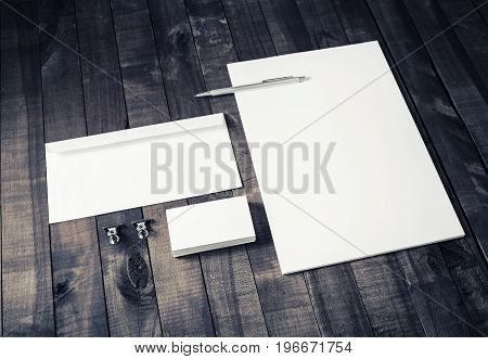 Blank stationery set on vintage wood background. Letterhead business cards envelope and pen. Mock up for branding identity. Blank ID template.