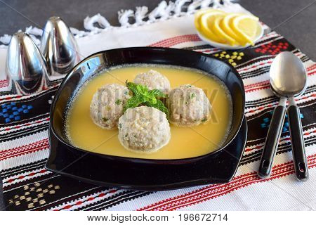Meatballs with mint and rice in a lemon-egg sauce. Traditional greek food. Healthy eating concept. Mediterranian lifestyle