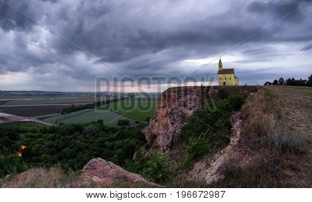 Breathtaking colorful sunset and Drazovce church in Slovakia