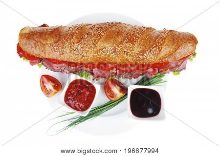 french sandwich over white plate: baguette with chicken smoked sausage and sauces isolated on white background