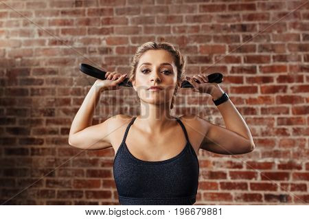 Young Woman Doing Neck Exercises Using A Band.