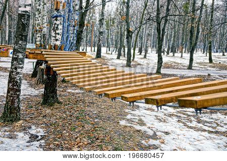 Wooden stairs tension in the winter park