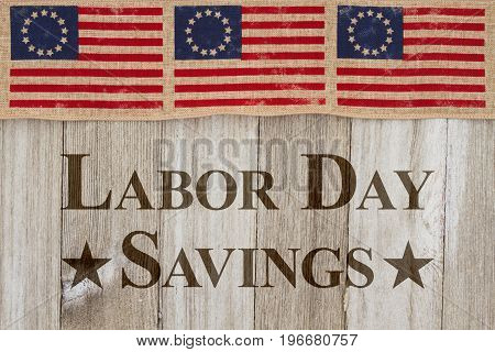 Labor Day savings message USA patriotic old flag on a weathered wood background with text Labor Day Sale