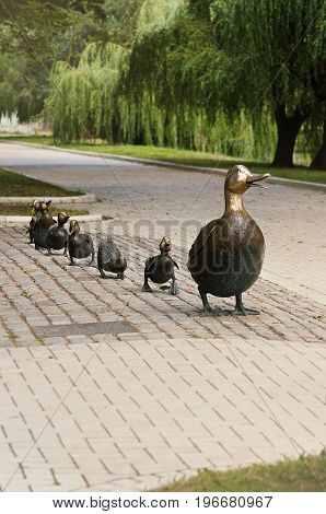 Park near Novodevichy convent in Moscow, Russia, 24 July 2014. Bronze sculpture of mother duck with ducklings, a symbol of peace between Russia and the United States. Author Nancy Shen.