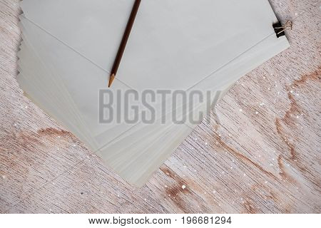 White paper and pencil on old wooden floor.