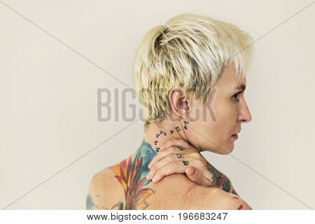 Woman shirtless with tattoo on the back side